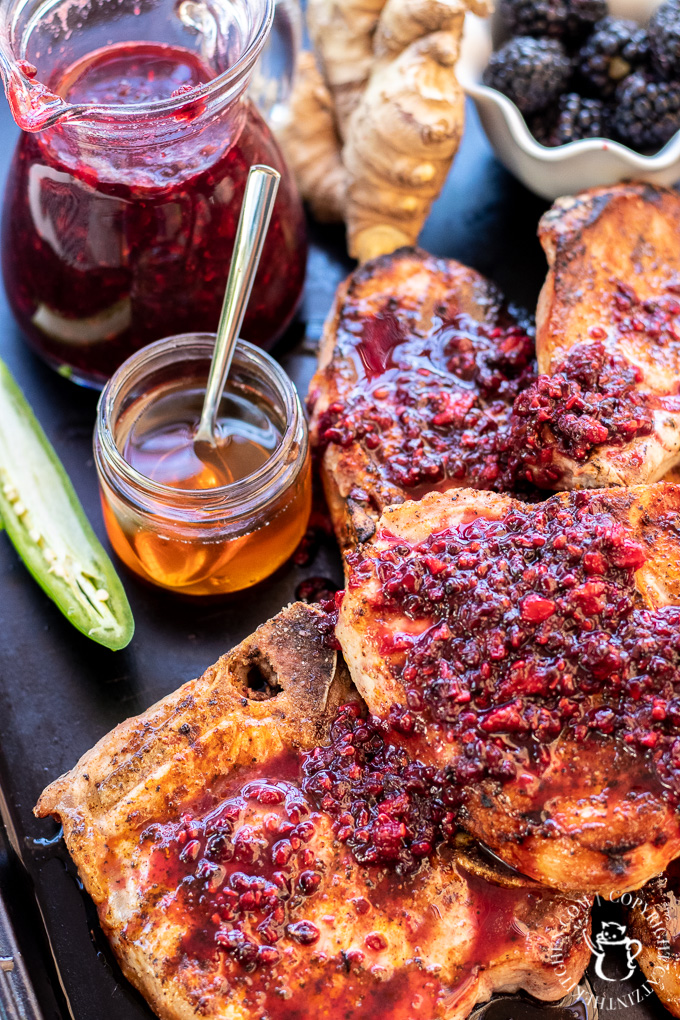 These grilled pork chops with blackberry sauce are a delightful whirlwind tour of your palate's capabilities and a must-grill this season!
