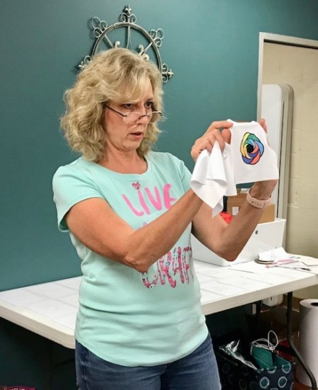 Photo of Lycia Evanoff demonstrating sublimation with markers