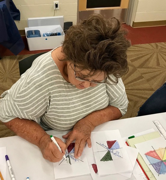 Photo of woman drawing with sublimation markers