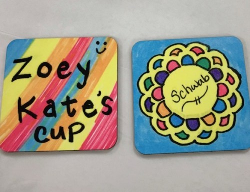 Photo of sublimated coasters with hand-drawn designs