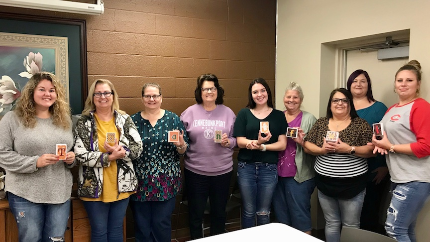 Group of ladies with completed craft project