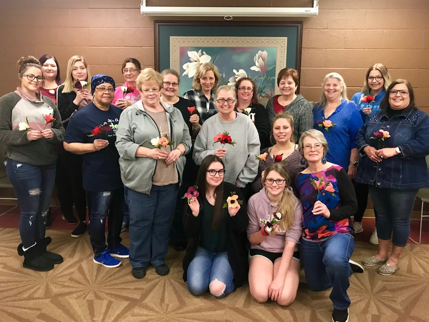 Women at Creative Cutters crafting group meeting