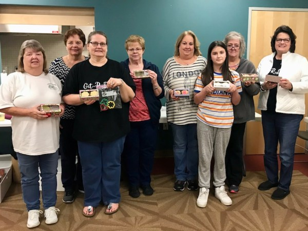 Creative Cutters group with cookies and cookie boxes