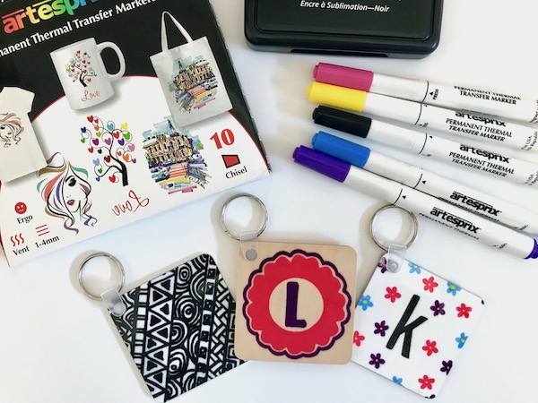 Sublimated keychains created with sublimation markers and sublimation stamp pad