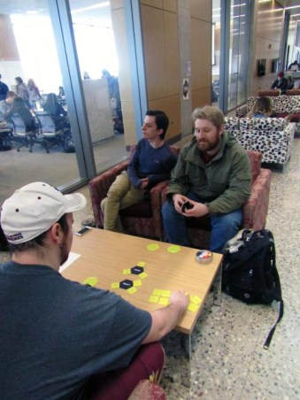 Rob Blunier, Sophomore (top left), Zane Sarafiny, Freshman (bottom left), and Geoffrey Wing, Senior (top right) play a card game in the Bio-Science building to pass the time and bond as friends. Thursday, February 23, 2017.