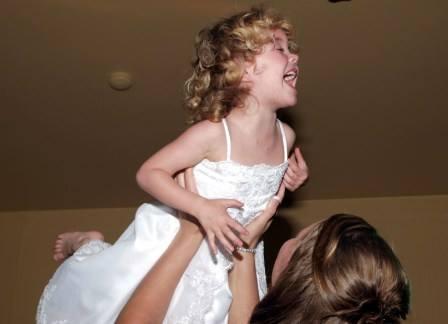 Little girl enjoying family focused North Georgia Weddings at Cavender Castle