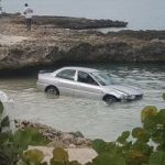 Driver loses control and lands in ocean