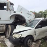 Dump truck and car crash head-on in BT