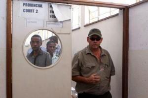 Zimbabwean hunter Theo Bronkhorst leaves court in Hwange, October 15, 2015. REUTERS/Philimon Bulawayo