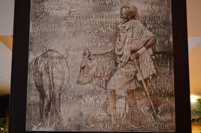 Pintura de un guerrero masai con su ganado