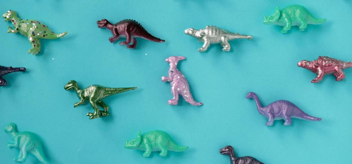 Dinosaur toys on turquoise background