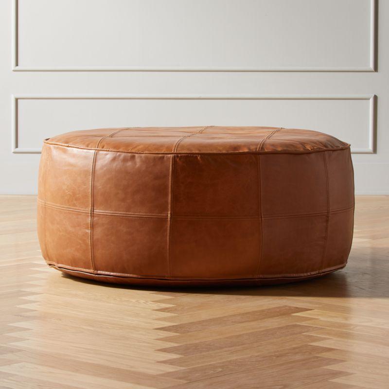 round saddle leather pouf ottoman