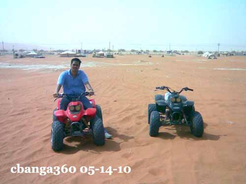 riding an ATV on the red sands of Saudi