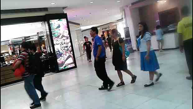 Watch busy foot traffic on mall hallway intersection