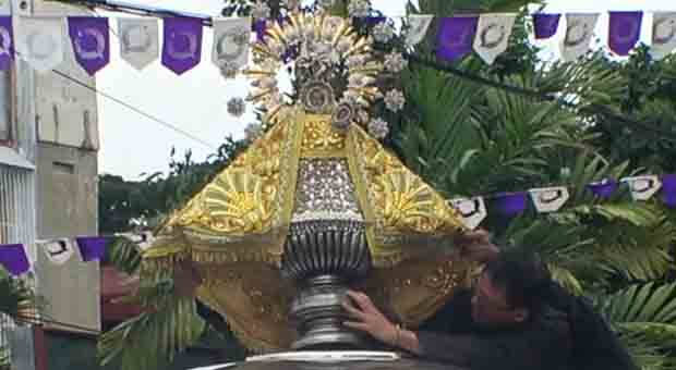 The venerated image (replica) of the Virgin of Penafrancia, being installed pror to the street and fluvial procession that start from the cathedral after the mass which concludes at 3 pm.