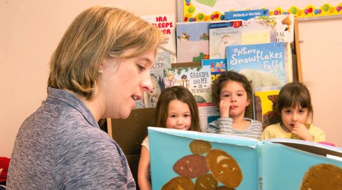 Sam reading to children in the Parparim Classroom
