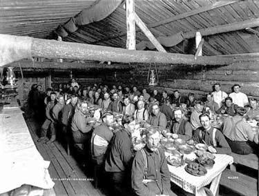 Men Eating at a Logging Camp
