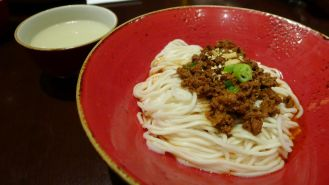 """The Sichuan """"dan dan"""" noodles with spicy minced pork sauce (川式坦坦麵) was incredibly spicy but tasty. The dish is portioned for one. Once you get over the heat, you'll want to have another. The soup is to chase the spiciness."""