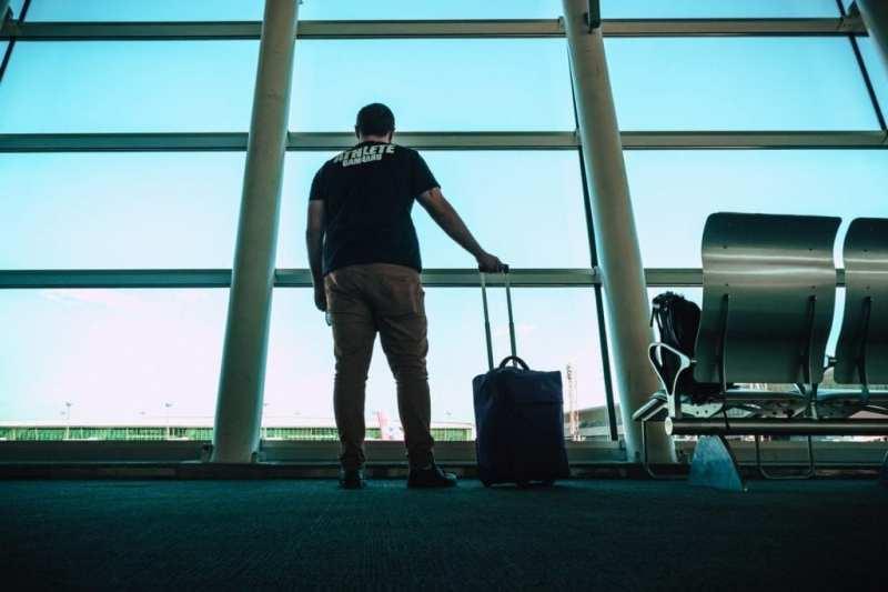 man holding luggage bag