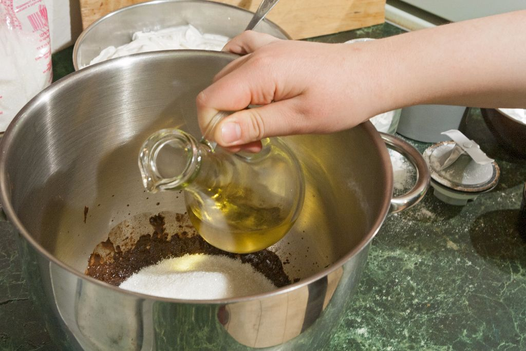Pouring the oil into the mixing bowl