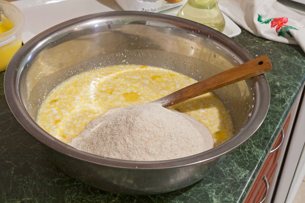 Intermixing the rest of whole wheat flour into the egg mix