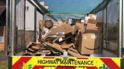Cardboard boxes on van