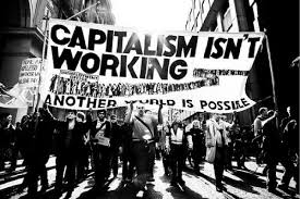 "Marchers with banner that reads, ""Capitalism Isn't Working: Another World is Possible"""