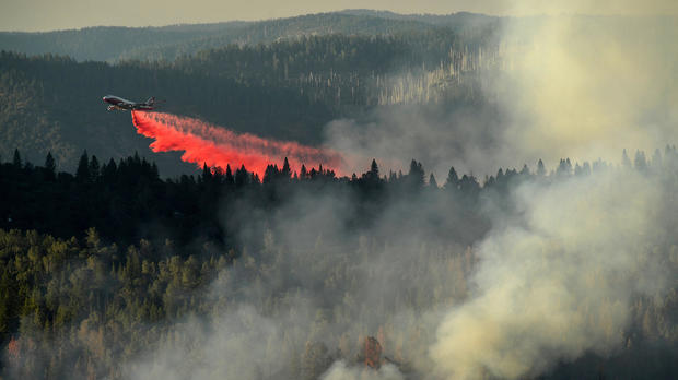 A 747 SuperTanker drops retardant while battling the Ponderosa Fire east of Oroville, California, Aug. 30, 2017.