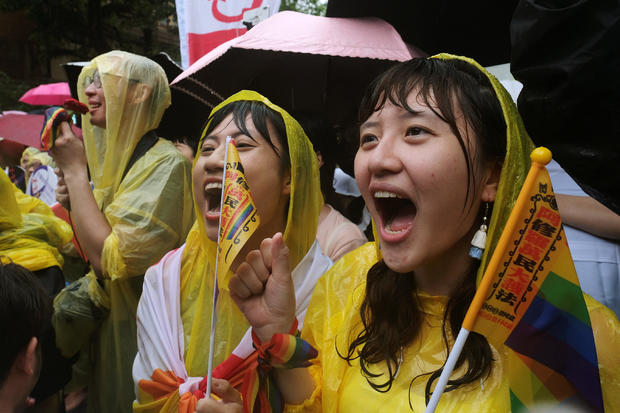 Same-sex marriage supporters shout during a parliament vote on three draft bills of a same-sex marriage law, outside the Legislative Yuan in Taipei