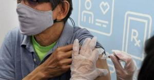 Will I have to wear a mask once I get the COVID-19 vaccine?