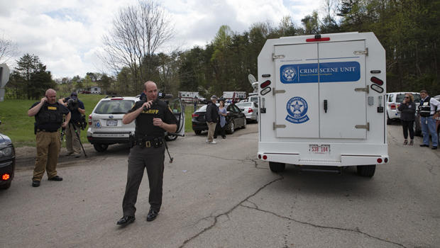 Authorities allow crime scene investigation vehicles to pass a perimeter checkpoint near a crime scene April 22, 2016, in Pike County, Ohio.