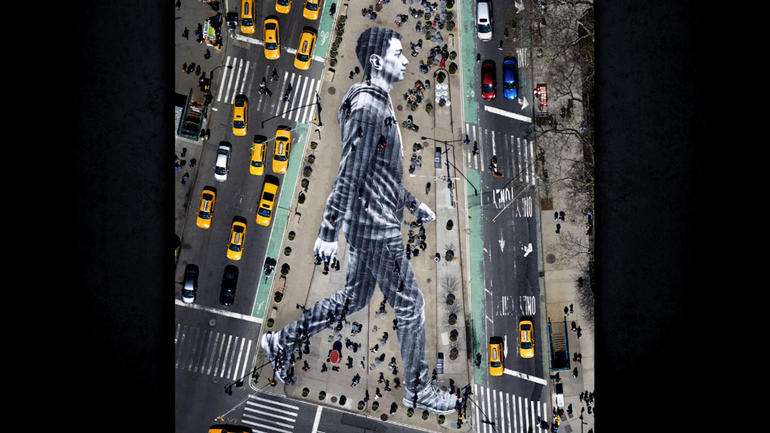 Larger than life displays by French photographer JR - CBS News