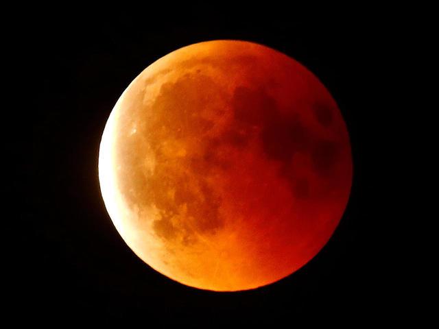 A blood moon is seen in the sky over Frankfurt