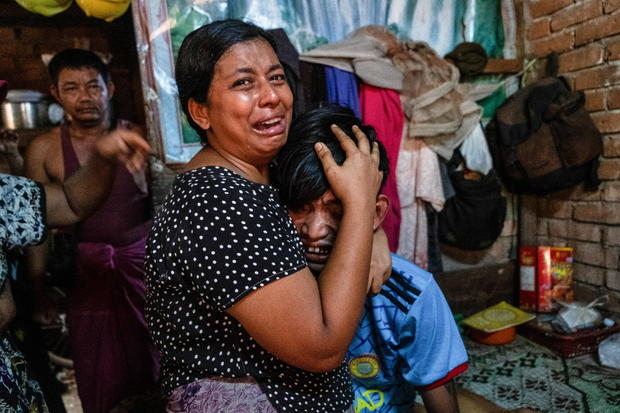 Family members mourn a man after he was shot dead during anti-coup protests in Yangon