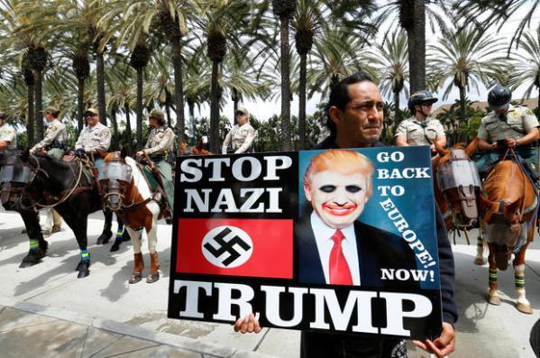 Police break up Trump protest in Anaheim - CBS News