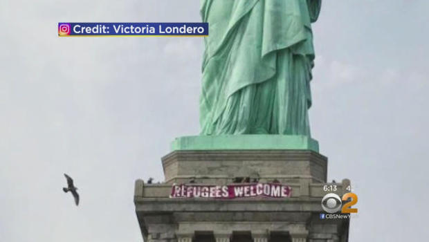 Image result for statue of liberty refugee banner