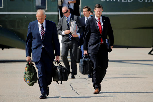 Porter and Kelly walk to board Air Force One with Trump at Joint Base Andrews, Maryland