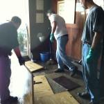 Volunteers removing the flooring at West End Temple after Superstorm Sandy.