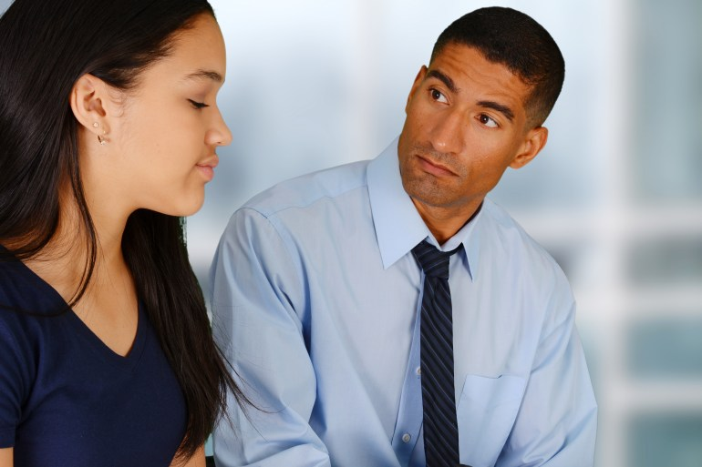 woman and man talking after returning to work place