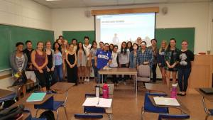 Gustavo Jr takes a picture with the students at UC, Santa Barbara