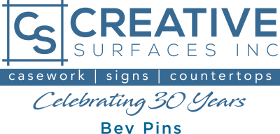 Creative Surfaces Commercial Logo_30Year_BevPins