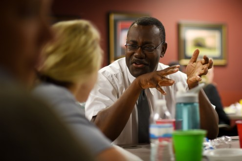 Dr. Thaddeus Ulzen, associate dean for Medical Education, chats with a first-year medical student over lunch.