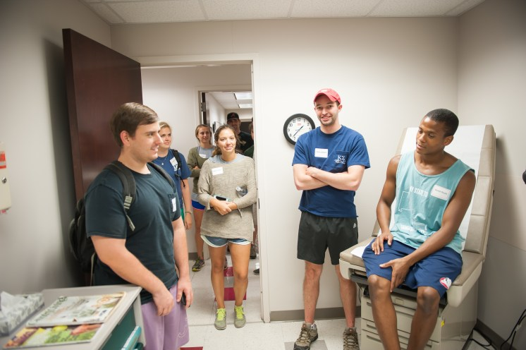 First-year medical students get a peek at an exam room in University Medical Center.