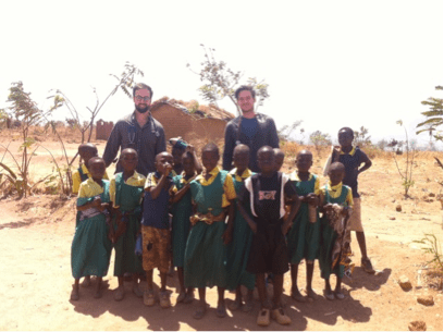 Daniel Stanley, third-year medical student and Rural Medical Scholar at the College, with Jesse Ross, a medical student at the University of Alabama at Huntsville and a member of the Auburn-Huntsvilel Rural Medicine Progam, with children in Malawi
