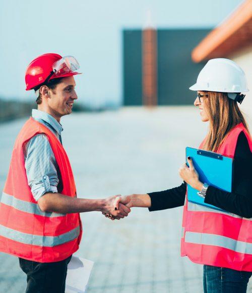 Handhaking on construction site