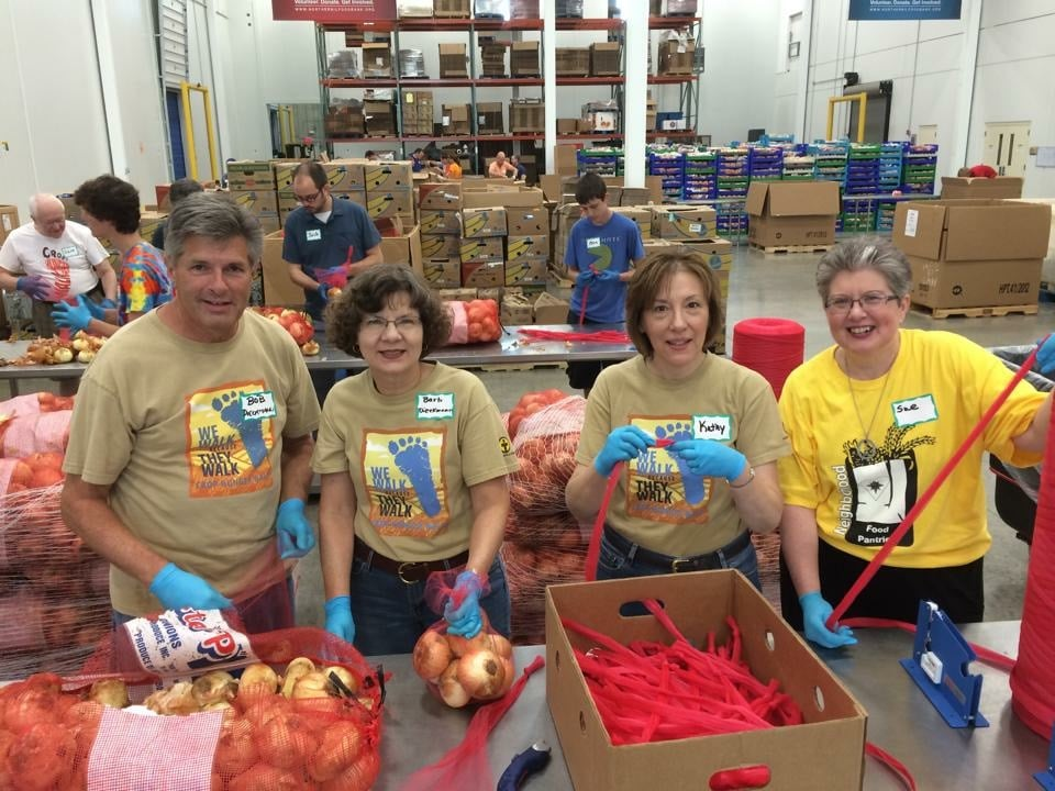 """""""A church group from West Chicago puts faith into action, working in Northern Illinois Food Bank's processing room. Thanks to volunteers, partners, and donors, a gift of $1 provides $8 worth of groceries to neighbors in need in Northern Illinois."""""""