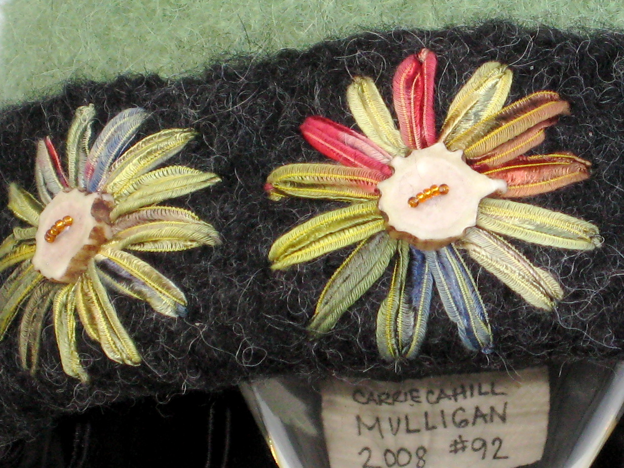 Detail of freehand ribbon embroidery with caribou antler buttons on knitted felt hat.