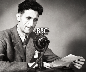 George Orwell at a BBC microphone.