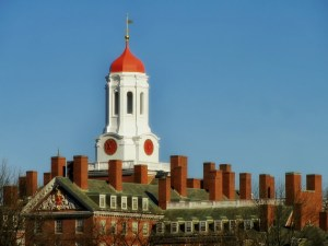 Harvard University white tower over red brick buildings. Photo Courtesy Pixabay