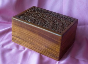 carved top wooden urn
